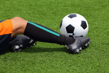 Player slide for catching the soccer ball on grass field, Clipin