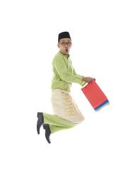 indonesian male shopping and jumping in joy during hari raya ra
