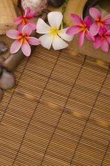 tropical spa setup with traditional frangipani flower and massag