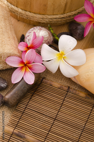 tropical spa setup with traditional frangipani flower and massag