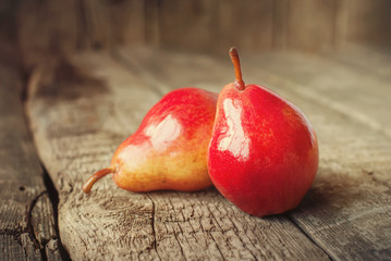 Composition with Two Red Pears on the wooden table, toned warm
