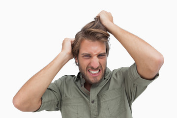 Frustrated man pulling his hair