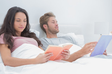 Couple reading in their bed