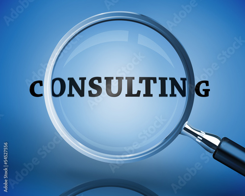Magnifying glass showing consulting word