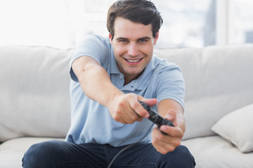 Portrait of a man playing video games