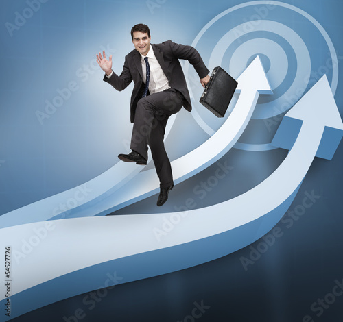 Businessman jumping over blue arrows