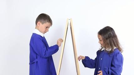 children draw on the blackboard at school