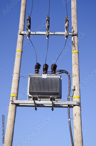Wooden Utility Pole with Power Lines and transformer on sky
