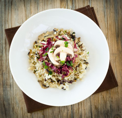Rice with mushrooms, zucchini, radicchio and parsley