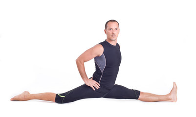 Practicing Yoga exercises:  Monkey Pose - Hanumanasana