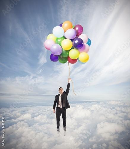 Businessman flying high