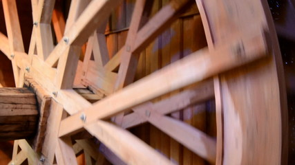 A Wooden Water Wheel In Action