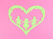 Green cut out paper heart with people inside,