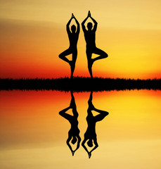 Yoga couple at sunset