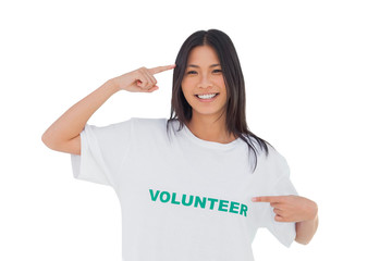 Smiling woman pointing to her volunteer tshirt