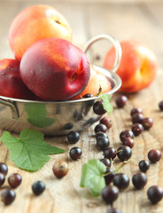 Nectarines and black currant. Selective focus