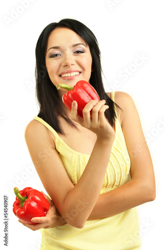 Girl with fresh peppers isolated on white