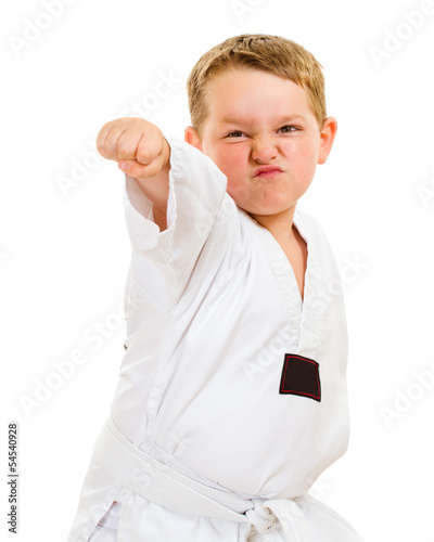 Child practicing his taekwondo moves isolated on white