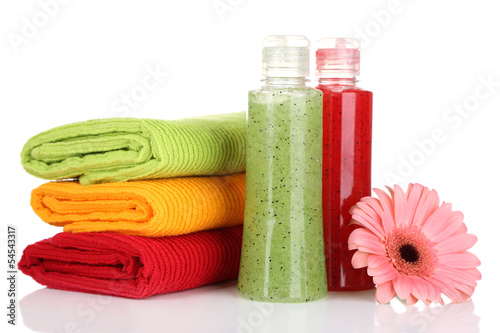 Colorful towels and cosmetics bottles, isolated on white