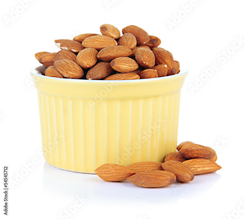 Almond in bowl, isolated on white