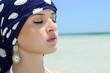 beautiful woman in a blue shawl on the beach. arabian style