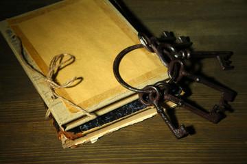 Antique keys and book on dark background