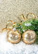 golden christmas ball with christmas tree branch