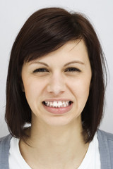 Young woman with white teeth snarl