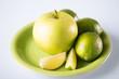 green apple in green bowl