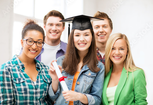 girl in graduation cap with certificate