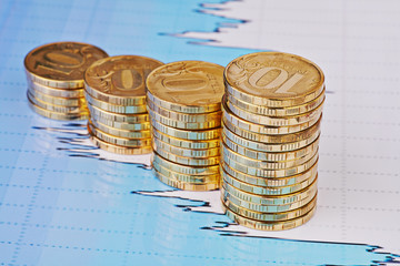 Uptrend stacks coins,on the financial stock charts as background