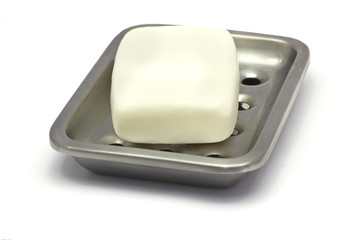 Bar of white soap in a holder