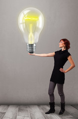 Beautiful lady holding realistic 3d light bulb