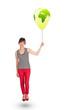 Happy lady holding a green globe balloon