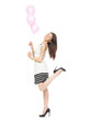 Young happy girl with balloons as a present for birthday