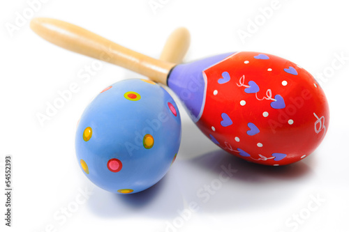 isolated two multicolored maracas on white