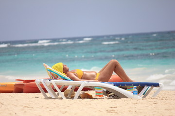 Tanning female in St. Barth, Caribbean