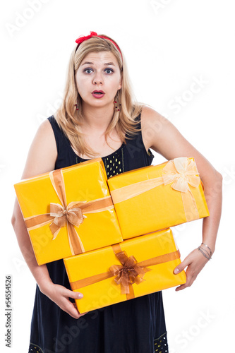 Shocked woman carrying presents