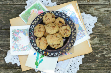Homemade walnut cookies and old postcards