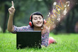 Asian female enjoy music on green field