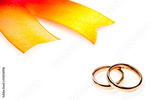 gold wedding rings near ribbon with space for text