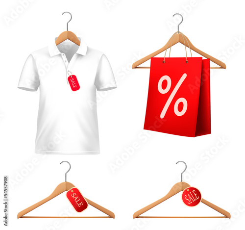Clothes sale set with hangers and price tags. Concept of discoun