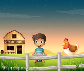 A boy holding an egg tray near the sleeping chicken