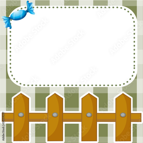 A stationery with a wooden fence and a candy
