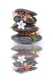 Zen stones and white flower with reflection over white