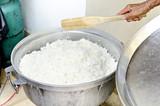 White thai Rice unpolished  in rice pot prepare for poster