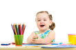 smiling child drawing and making by hands