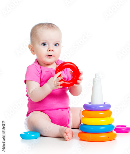 happy baby girl playing  toy isolated on white