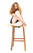 Ballerina girl child sitting on stool with clipping path over wh