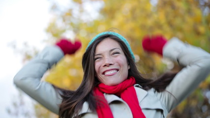 Fall woman cheering celebrating in forest
